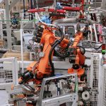 AutoGuide Robot Guidance Solution Loading Automotive doors in-line